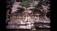 1964: a beautiful. rocky and rugged canyon wall along a body of water EVANSTON Stock Footage
