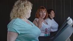 Fatty Women Having Treadmill Workout Stock Footage