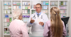 Female Purchaser Elderly and Young Women Get Assistance Helpful Pharmacist Man Stock Footage