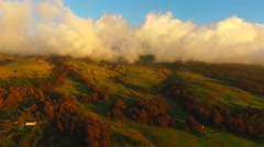 Tropical mountain tops with clouds at sunset, Maui, Hawaii Stock Footage