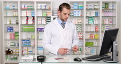 American Pharmacist Man Cutting Capsule Foil Dosing Pill Pharmacy Store Activity Stock Footage
