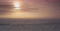 Waves of blizzard snow and clouds pass over tundra in storm Stock Footage