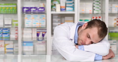 Tired Pharmacist Man Asleep Desk Counter Overwrought Druggist Sleeping At Work Stock Footage