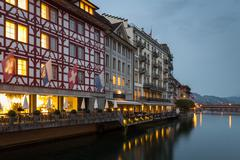 Historic timbered buildings on Lucerne waterfront Stock Photos