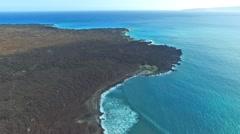 Aerial flight over lava fields and surf, Hawaiian Island of Maui Stock Footage