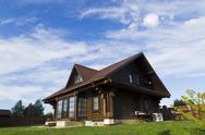 Wooden house sunny summer day Stock Photos