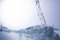 Clear water on a monochromatic background, abstraction Stock Photos