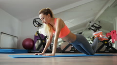Woman make pilates exercise lying on floor in gym Stock Footage