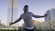 Carefree Man Listens To Music On Smartphone, Sings And Dances In City Park Stock Footage