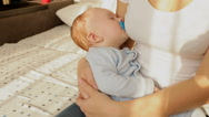 Cute 3 months old baby boy sleeping on mothers hands Stock Footage