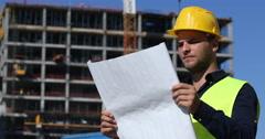 Engineer Man Analyzing Scheme Plan Looking Sideways Concrete Structure Building Stock Footage