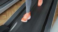 Female foot running on treadmill - motion blur Stock Footage