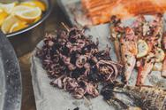 Seafood, fish, octopus grilled at barbecue Stock Photos