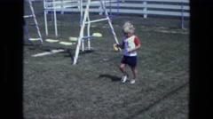 1975: a kid is seen near a swing CALIFORNIA Stock Footage