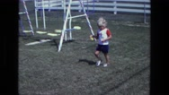 1975: a kid is seen near a swing CALIFORNIA Stock Footage