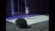 1975: a kid is seen opening a door CALIFORNIA Stock Footage