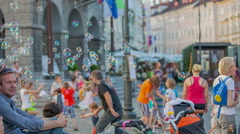 Fun day playing with bubbles in the city center Stock Footage