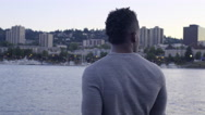 Portrait Of A Man Enjoying View Of City And River, From A Dock Stock Footage