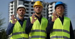 Trustful Engineers Men Look Camera Confident Show Ok Sign About Modern Building Stock Footage