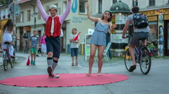 Two dancers are slowly moving on a red oval carpet Stock Footage