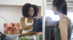 4K Cashier taking credit card payment from a customer at grocery store checkout Stock Footage