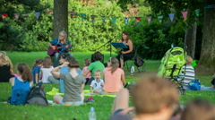 Young couple is enjoying the concert in the park Stock Footage