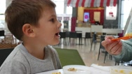 Mom tries feed her son but little kid boy spits out food and refuses to eat Stock Footage