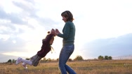 Mom playing with little child daughter on autumn meadow nature in sunset light Stock Footage
