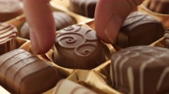 Chocolate from box picking by hand of  many different 4K 2160p 30fps UltraHD Stock Footage