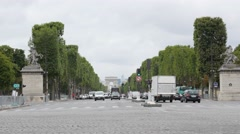 PARIS, FRANCE - JULY 2015 Traffic on Champs Elysees to the Arc de Triomphe fr Stock Footage