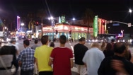 POV hyperlapse traffic crowd Hollywood Boulevard and Vine at night Stock Footage