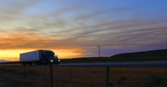 Freight truck driving on rural freeway road in California at sunset. 4K UHD Stock Footage