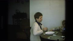 1975: two women and a small boy gathered at the dining room table CALIFORNIA Stock Footage