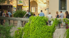 People are walking around in the old part of town Stock Footage