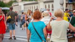 People are walking around the city center in the summer time Stock Footage