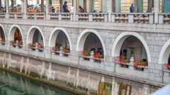 A nice cafe next to a river in the city center Stock Footage