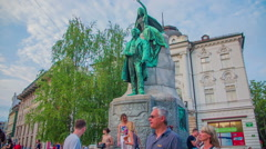 People are standing around France Preseren monument in a city center Stock Footage