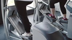 Working Out on Elliptical Trainer Stock Footage