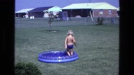 1975: a shirtless young child walking in circles around a kiddie pool CALIFORNIA Stock Footage