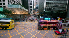 BUSES TAXIS CROSS JUNCTION CENTRAL HONG KONG CHINA Stock Footage