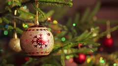 Decoration bauble on decorated Christmas tree Stock Footage