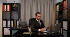 Good Looking Business Man Paying Invoices and Counting Usd Bills Office Interior Stock Footage
