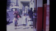 1964: a family walking downtown on a sunny and windy summer holiday SAN JUAN Stock Footage