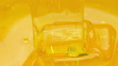 Pouring honey. Close-up Stock Footage