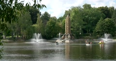 """Visitors ENEA boating . Fountain """"Kolos"""" in the center of the pond Stock Footage"""