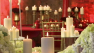 View of lighted candles on roses backdrop Stock Footage