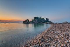 Isola Bella in Taormina at sunrise Stock Photos