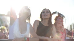 Female friends dancing at summer festival Stock Footage