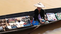 Woman on wooden boat selling souvenir, trinkets and bijouterieat, Myanmar. Burma Stock Footage