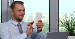 Positive Businessman Manager Browsing Digital Tablet and Smiling Company Office Stock Footage